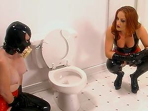 A g/g victim in a gas mask gets disciplined by her mistress