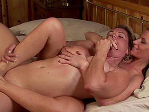 Two glorious dykes dildoing and fingerblasting each other