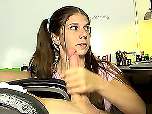 Pretty nubile with ponytails gives a handjob and sees TV