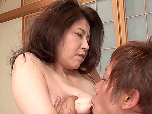 Modest Asian cougar taking off her kimono to be fucked
