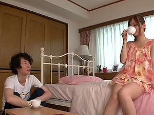 Sassy Japanese stunner sucking nutsack as she gives a stimulating handjob
