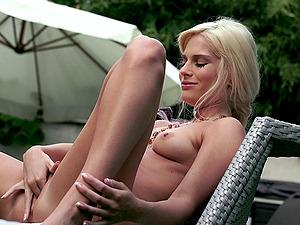 Uber-cute blonde in stockings finger-tickling her sweet cunt outside