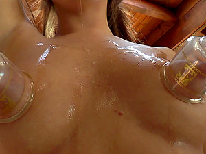 Applying absorption cups to her tits and masturbating