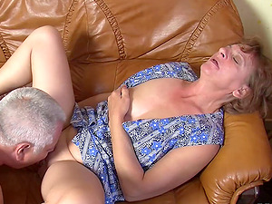 Giddy granny gets fucked foolish on the couch after sucking a dong