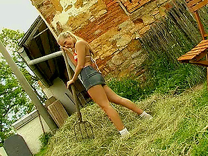 Nice farm nymph takes a break to masturbate in a pile of hay