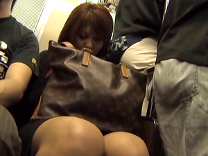 Guys grope the super-cute Japanese woman in a mini-skirt on the train