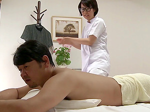 His sexy Asian rubdown therapist kneads him down and fucks him