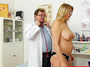 Big tits mummy shows off her hairy cunt while having an check-up at her doc's