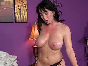 He gets to fondle the big oiled up tits of this hot mummy