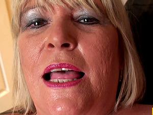 Fat mature blonde woman talking dirty and masturbating