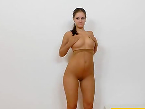 Solo brown-haired in high stilettos has a massive nylon fetish