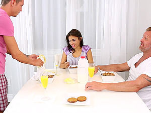 A lunch threesome leads to two guys fucking her on a table