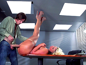 After hours a lucky stud gets to ravage his huge-chested, blonde manager