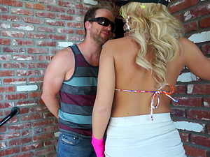 Tantalizing blonde with colorific glasses in the outdoors session