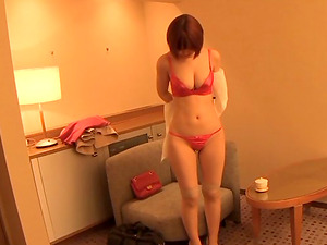Hidden camera catches a sexy Japanese damsel getting clothed