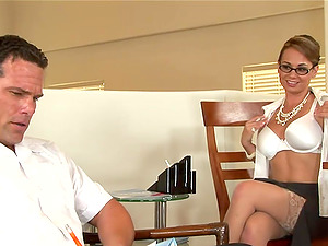 Holly West a wonderful chic with glasses lies on a table to be fucked
