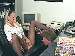 Assistant tramp arched over her desk and fucked up the donk