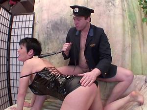 Cop puts a belt around her neck and fucks her mature labia