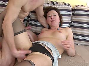 Sexy mature sucker sits her vulva down on his boner