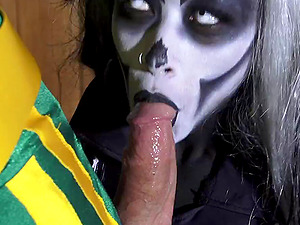 Chick with lots of black and milky makeup gives a stunning blow-job