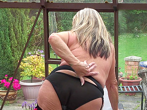 Buxomy Brit mature stunner strips in seamed stockings