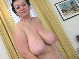Big beautiful woman with massive forms engages in the onanism