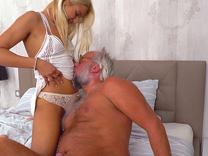 Golden-haired hotty lets the geezer penetrate her cock-squeezing little cunny