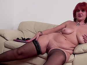 Sandy-haired mature granny with nice arse pissing in glass