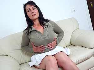 Lengthy hair matured dark haired looking enticing displaying her tits