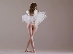 Enticing black-haired ballerina strips and practices in the nude