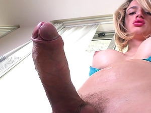 Shemale with a massive erection penetrates herself with a pink fucktoy