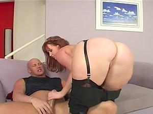 Chubby in high high-heeled slippers providing hard-on handjob displaying her big donk