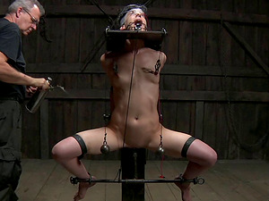 Dark-haired gimp widened gams when tormented in Sadism & masochism shoot