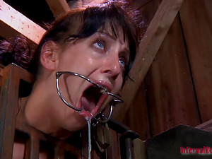 Encaged sub having her mouth widened in Domination & submission torment