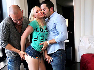 Pretty blonde named Lola treats two schlongs at the same time