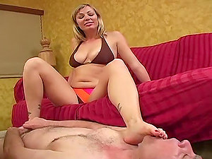 Big-titted Adrianna Nicole gives a footjob to a dude and sits on his face