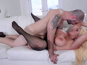 Grabbing Alura Jenson's faux tits while screwing her
