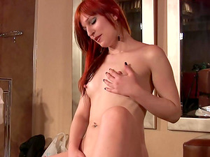 Sexy ginger-haired works her labia in the douche