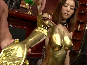 Japanese sex slave covered in golden paint tied to a leash