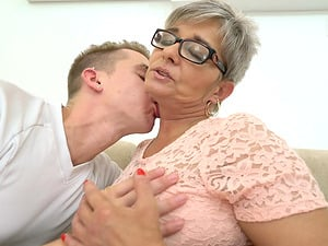 Granny Jessye getting kissed and fucked by younger Oliver