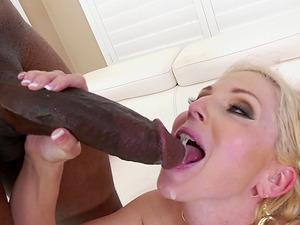 Dick craving blonde Christie Stevens has a black dick up her anus