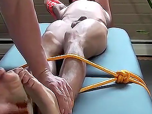 Justin is tied up good and has to endure a tickling session