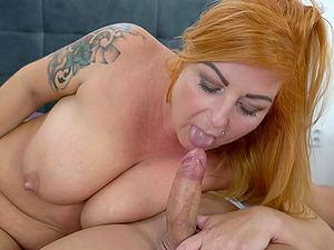 Experienced chubby Tammy Jean is a natural redhead with saggy tits