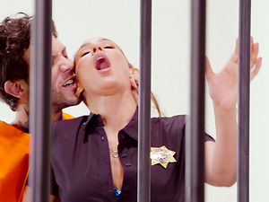 Policewoman Isis Love fucked well by a tattooed horny inmate