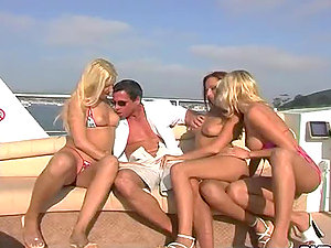 Peter North fucks three hot chicks on a beautiful yacht