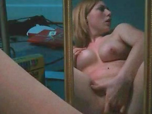 Hot girl masturbating in front of a mirror