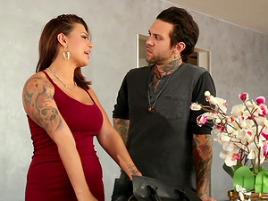 Elegant brunette offers her body to a tattooed hunk