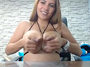 Girl with some huge boobies milking her tits live on webcam