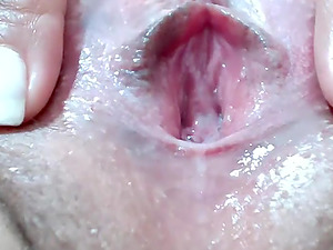 Milf really enjoys toying her big shaved pussy