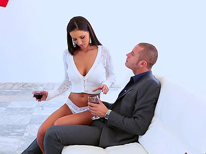 Busty brunette Angel Dark is on top of her passionate lover